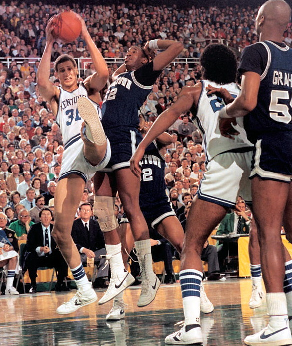 Sam Bowie Grabs The Ball In Front Of Ralph Dalton While Winston Bennett And Michael Graham Look On